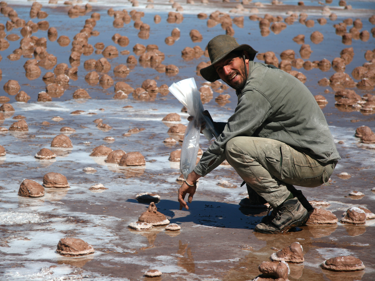 Colleague Fernando Gomez examining mineralized oncolites of Laguna Negra