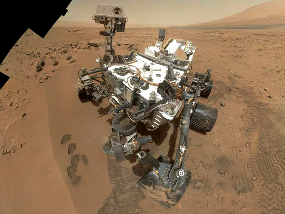 Self-portrait of the Curiosity rover at the Rocknest sample site, taken by MAHLI