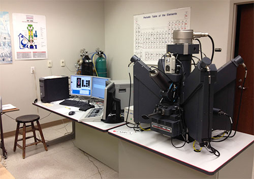 Alan Patchen sits with one of the Department's major analytical instruments, the Cameca SX-50 Electron Microprobe with four wavelength spectrometers and and energy dispersive system (EDS).